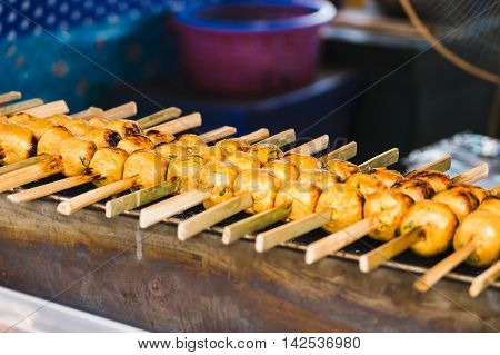 Grill fish ball with curry paste on toaster