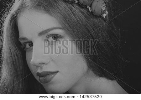 Pretty brunette with a wreath in her hair black-and-white photo