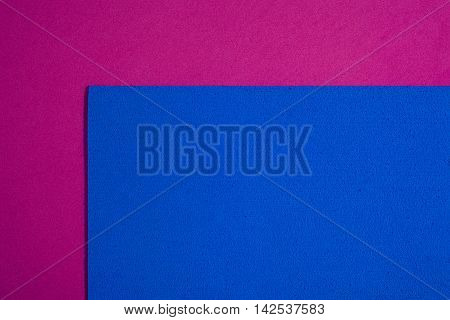 Eva foam ethylene vinyl acetate sponge plush blue surface on pink smooth background