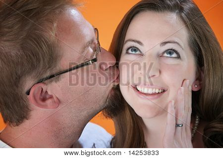 Man Kisses Woman