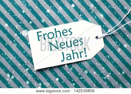 One Label On A Turquoise Striped Wrapping Paper. Textured Background With Snowflakes. Tag With Ribbon. German Text Frohes Neues Jahr Means Happy New Year