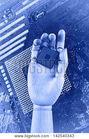 Robotic hand holding central processing unit on circuit board background. Future technologies concept.