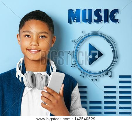 Cute afro american teenager  with phone and headphones on blue background