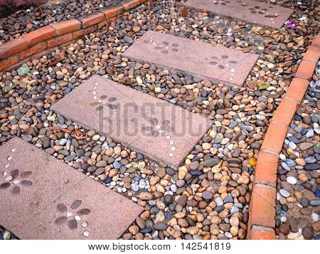 stone walkway and bricks in garden - stone pathway