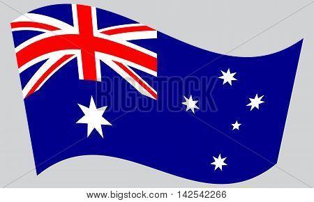 Flag of Australia waving on gray background. Australian national flag.