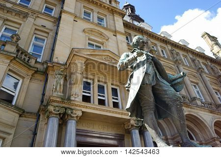 Statue of a figure outside a post office