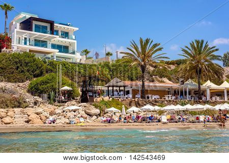 PAPHOS CYPRUS - JULY 24 2016: Coral Bay Beach one of the best sandy beaches of the region.