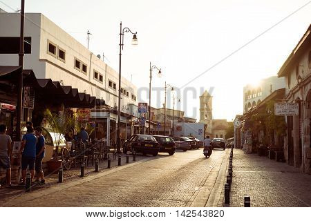 LARNACA CYPRUS - AUGUST 16 2015: Sundown at old street leads to the Lazarus Church in the center of the old town of Larnaca.