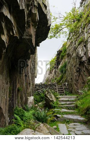 Hiking path climbs over a rocky wall