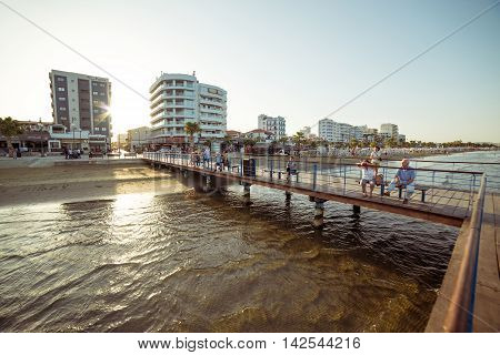 LARNACA CYPRUS - AUGUST 16 2015: Locals and tourists at Castle square pier.