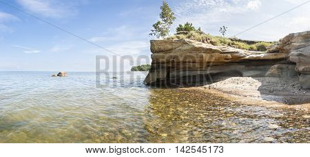 Summer landscape of a seashore and a cliff