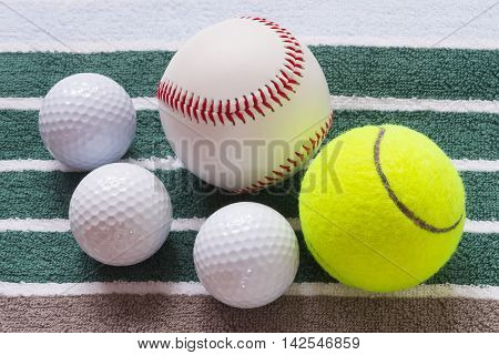 Different balls on a striped towel, background towel
