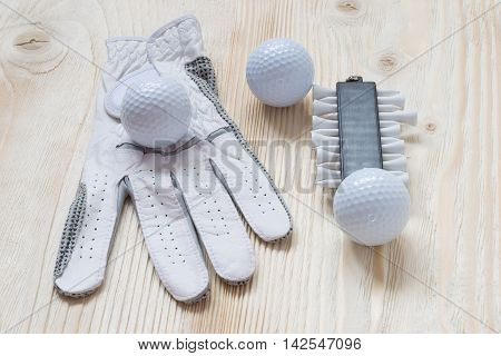 glove and golf balls on a light surface
