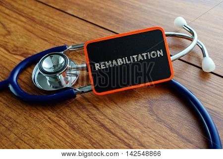 Medical Concept.word Rehabilitation With Stethoscope On Wooden Table.