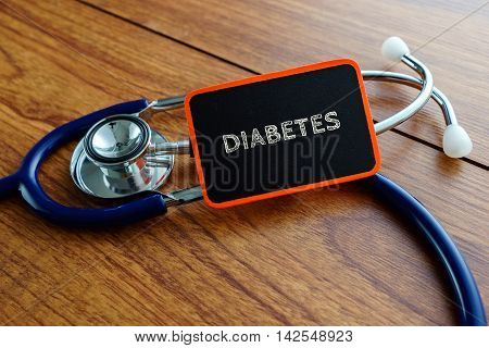 Medical Concept.word Diabetes With Stethoscope On Wooden Table.