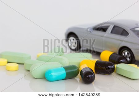 horizontal photo of medicine with blurred gray car on the background