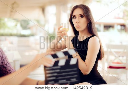 Surprised Actress Holding a Glass in Movie Scene