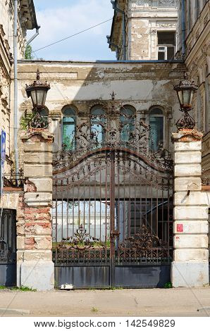 Wrought iron openwork metal gate of old house Kostroma Golden ring of Russia