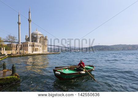 ISTANBUL, TURKEY - APRIL 13, 2016: Man on his boat on the Bosphorus, Istanbul, Turkey.