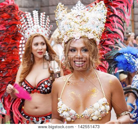 STOCKHOLM SWEDEN - JUL 30 2016: Women from south america dressed in colorful carnival clothes and a bra made of shells in the Pride parade in the Pride parade July 30 2016 in Stockholm Sweden