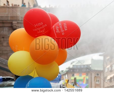 STOCKHOLM SWEDEN - JUL 30 2016: Colorful balloons in red yelllow and blue in the Pride parade July 30 2016 in Stockholm Sweden