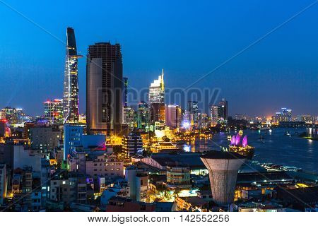 HO CHI MINH CITY, VIETNAM - CIRCA JAN, 2016: Top view of Saigon River at night time. Saigon River (the length of 256 kilometers) is most important to Ho Chi Minh City as it is the main water supply.
