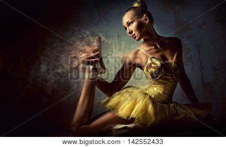 Lovely ballerina in yellow tutu. Image with a digital effects