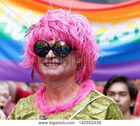 STOCKHOLM SWEDEN - JUL 30 2016: Senior smiling transvestite man with a pink wig in the Pride parade July 30 2016 in Stockholm Sweden