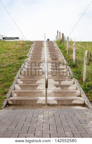 an concrete stairway lies next to the bridge in Netherlands