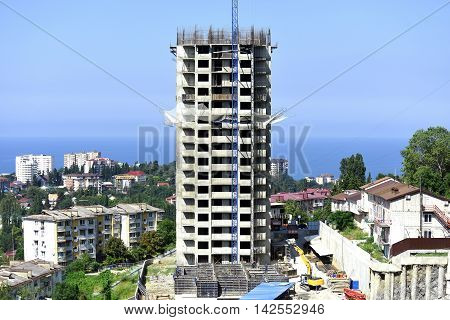 The construction of the new high-rise buildings of concrete and steel