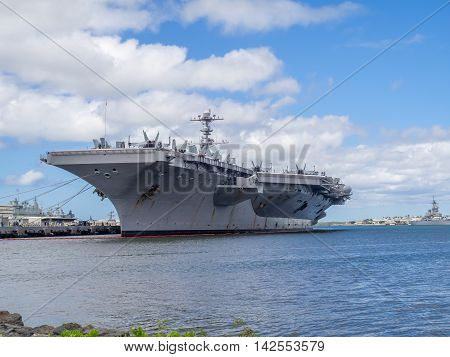 USS John C. Stennis parked at Peral Harbor In Honolulu.