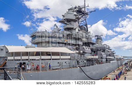 OAHU, HI - AUG 5, 2016: USS Missouri battleship museum on August 5, 2016 in Pearl Harbor, USA. Site of the treaty signing ending WWII between the US and Japan, is now berthed in Pearl Harbor Hawaii.