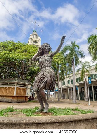 HONOLULU, HI - AUG 6: View of the hula girl statue at Aloha Tower Marketplace on August 16, 2016 in Honolulu, Hawaii.