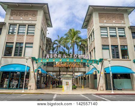 HONOLULU, HI - AUG 6: View of the new Aloha Tower Market Place on August 6, 2016 in Honolulu, Hawaii. Newly renovated Aloha Tower Marketplace is the gateway to Honolulu Harbor.