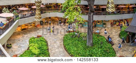 HONOLULU, HI - AUG 6: Garden courtyard view of the refurbished Royal Hawaiian Shopping Centre on August 6, 2016 in Honolulu. Waikiki tourists enjoy the many stores and restaurants.