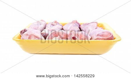 Packaging with chilled chicken drumsticks isolated on white background