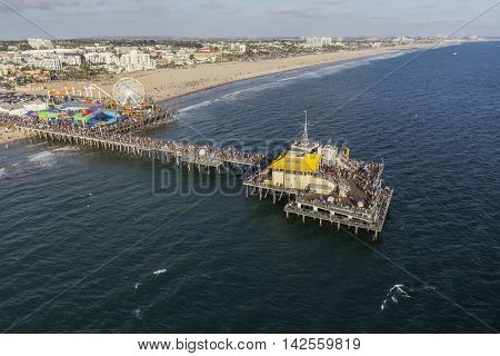 Santa Monica, California, USA - August 6, 2016:  Afternoon aerial of popular Santa Monica Pier and the Pacific Ocean near Los Angeles.