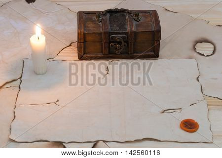 candle on a table near the treasure chest