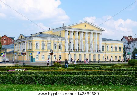 KOSTROMA RUSSIA - JULY 20 2016: Unidentified people walk on Susaninskaya square near house of General Borshchov Kostroma Russia