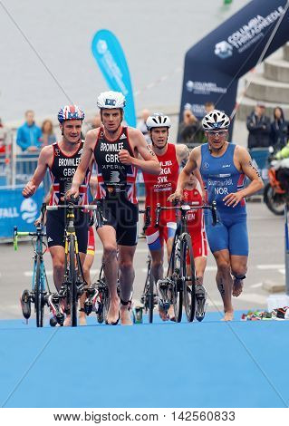 STOCKHOLM - JUL 02 2016: Triathlete Alistair Brownlee Jonathan Brownlee and competitors in the transition zone in the Men's ITU World Triathlon series event July 02 2016 in Stockholm Sweden
