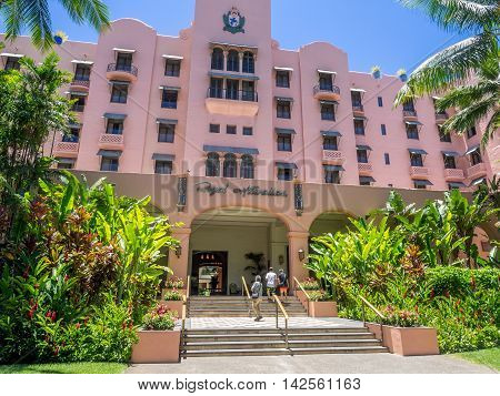 HONOLULU, USA - AUG 8: The refurbished Royal Hawaiian Hotel main entrance with palm and banyan trees providing shade on August 8, 2016 in Honolulu, Hawaii.