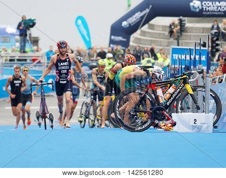 STOCKHOLM - JUL 02 2016: Triathletes running with bicyles in the transition zone in the Men's ITU World Triathlon series event July 02 2016 in Stockholm Sweden