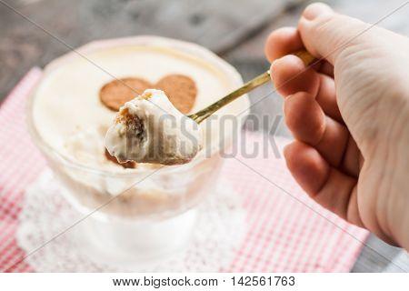 Tiramisu On A Spoon In His Hand