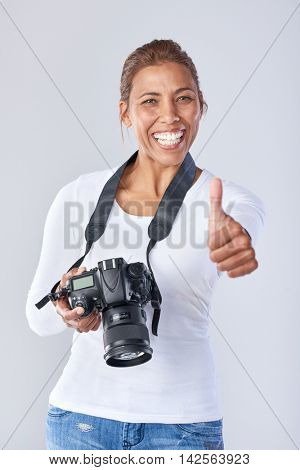 Confident woman holding dslr camera, completed  a successful learning course