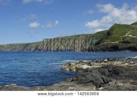 beautiful sea landscape view of Atlantic ocean and mountain cliffs and rocks at Mosteiros village in Sao Miguel Azores island in Portugal in Europe tourist destination and holiday travel concept