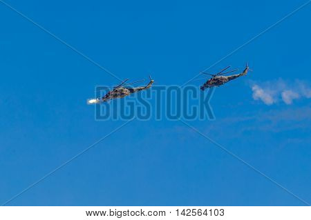 August 6 2016. Ryazan Russia. The helicopter of the Military Air forces of Russia launches missiles at an Airshow. Documentary Editorial Image.
