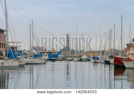 Yachts and boats in the old harbor of Genoa. Italy.