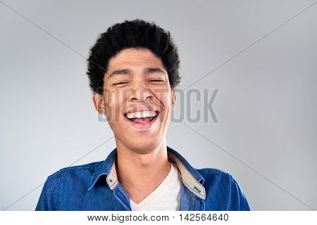 Genuine man laughing out loud with open mouth, happy friendly approachable