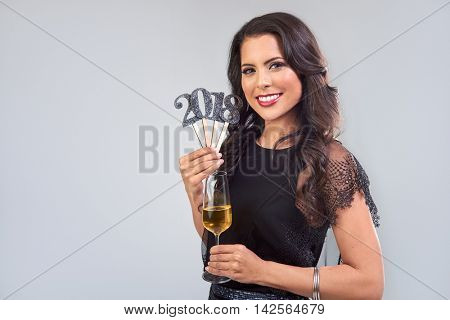 Pretty glamouros woman welcoming the new year 2018, photobooth style image