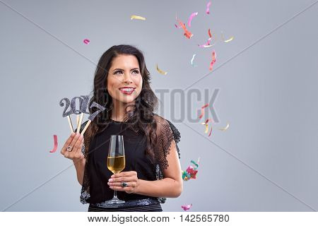 Pretty glamoros mixed race woman with red lips welcoming the new year 2017